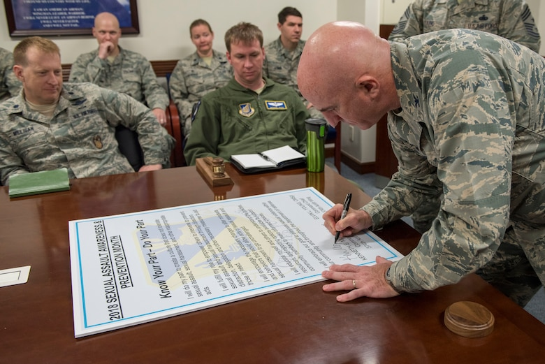 Col. Kenneth E. Moss, 374th Airlift Wing commander, signs the Sexual Assault Awareness & Prevention Month proclamation at Yokota Air Base, Japan, April 3, 2018.