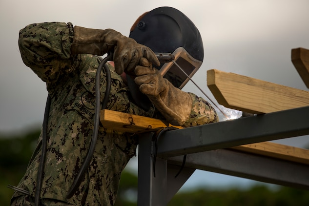 Seabees help marines for the Medal of Honor Hospital Corpsman 3rd Class Bush Battle Aid Station for the Correctional Custody Unit 2.0 program March 28 aboard Camp Hansen, Okinawa, Japan.