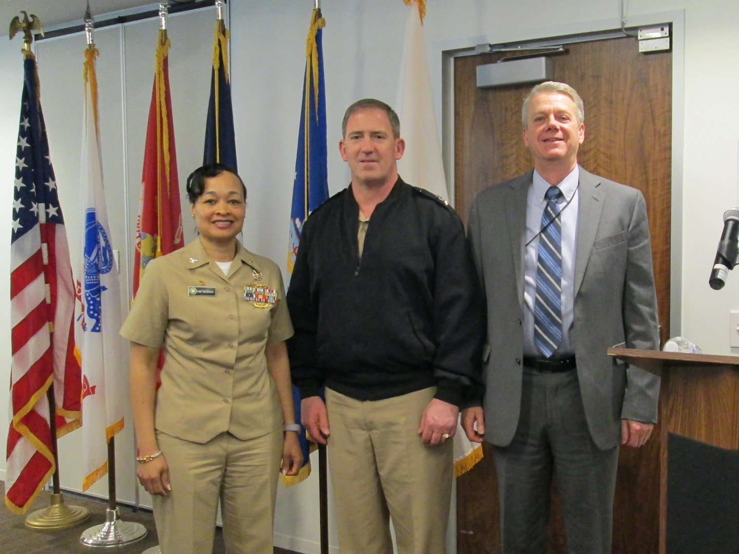 Navy Rear Adm. John Polowczyk (center), vice director for logistics on the Joint Chiefs of Staff, briefed the Defense Contract Management Agency Manassas team based in Chantilly, Virginia, on the National Defense Strategy, the joint strategic environment, and the important role DCMA plays in advancing the nation's defense objectives. Pictured from left to right: Navy Capt. Pamela Theorgood, DCMA Manassas commander; Polowczyk; and Stephen Sloboda, DCMA Manassas deputy commander. (Photo courtesy of DCMA Manassas)