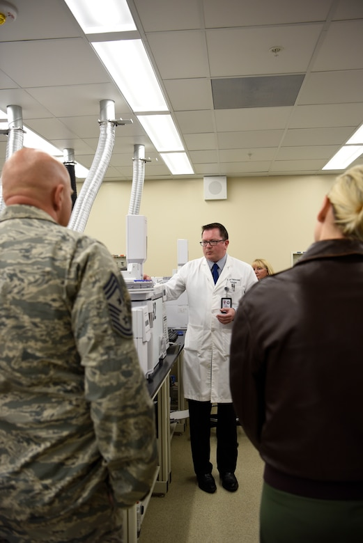 Dr. Jeffrey Walterscheid, Armed Forces Medical Examiner System Division of Forensic Toxicology chief toxicologist, shows civic leaders from MacDill Air Force Base the labs of AFMES during their tour March 29, 2018, at Dover AFB, Del. the group was given an inside look at Team Dover's mission over their two days visiting the base. (U.S. Air Force Photo by Airman 1st Class Zoe M. Wockenfuss)
