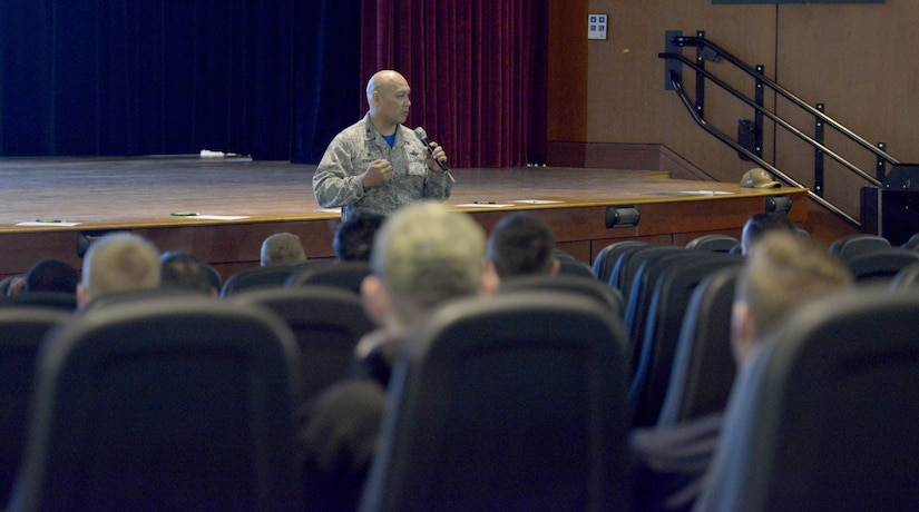 U.S. Air Force Col. Jimmy Canlas, 437th Airlift Wing commander, delivers opening remarks during the annual motorcycle rider's safety briefing March 30, 2018, at the Air Base Theater.