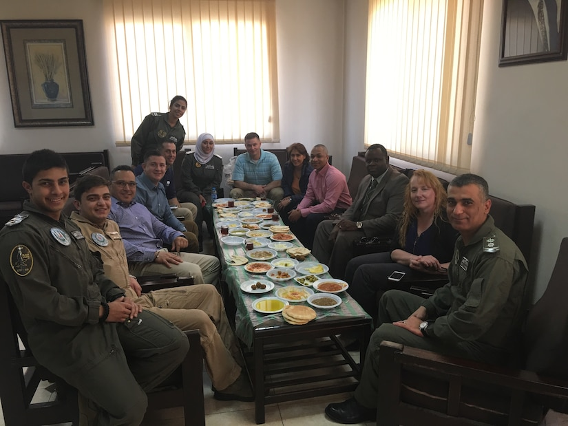 Members of the 248th Aviation Support Battalion and the 1st Battalion, 244th Aviation Regiment (Assault), Task Force Spartan enjoy a traditional Jordanian breakfast with the 8th Squadron commander and his team located at King Abdullah I Air Base, Marka. The 8th Squadron's mission is to support three battalions of a newly-developed quick reaction force unit that covers the entire country of Jordan.
