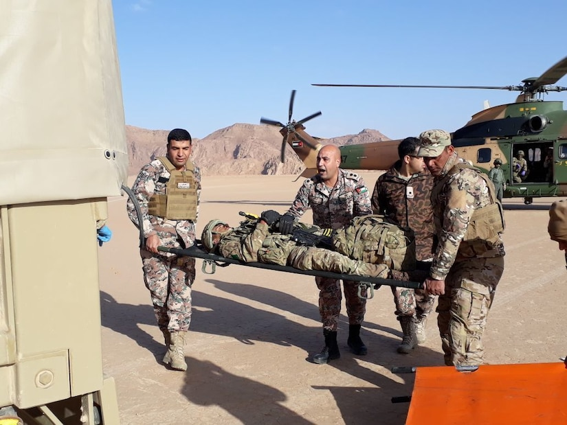Jordanian forces transfer a simulated injured soldier from a Super Puma helicopter into a ground ambulance during Exercise Olive Grove Feb. 22, 2018. U.S. Soldiers with the 248th Aviation Support Battalion and the 1st Battalion, 244th Aviation Regiment (Assault), Task Force Spartan observed the exercise that conducted infiltration, resupply, and exfiltration operations.