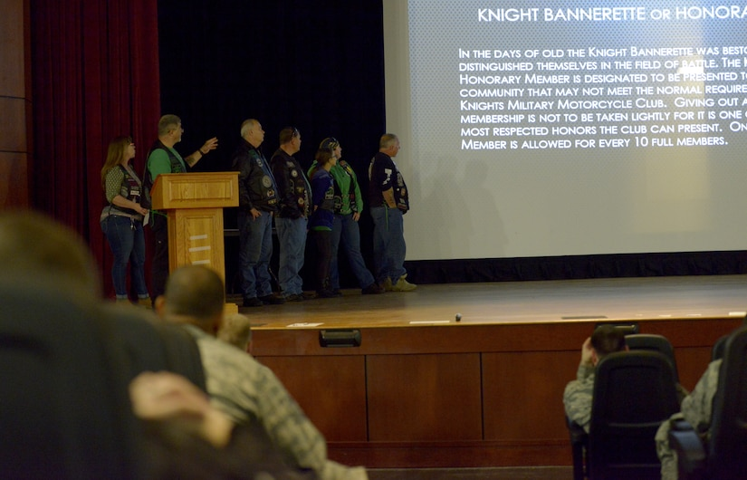 The 37th Chapter of Green Knights read the power point slide on honorary members during the annual motorcycle rider's safety briefing at the Air Base Theater March 30, 2018.