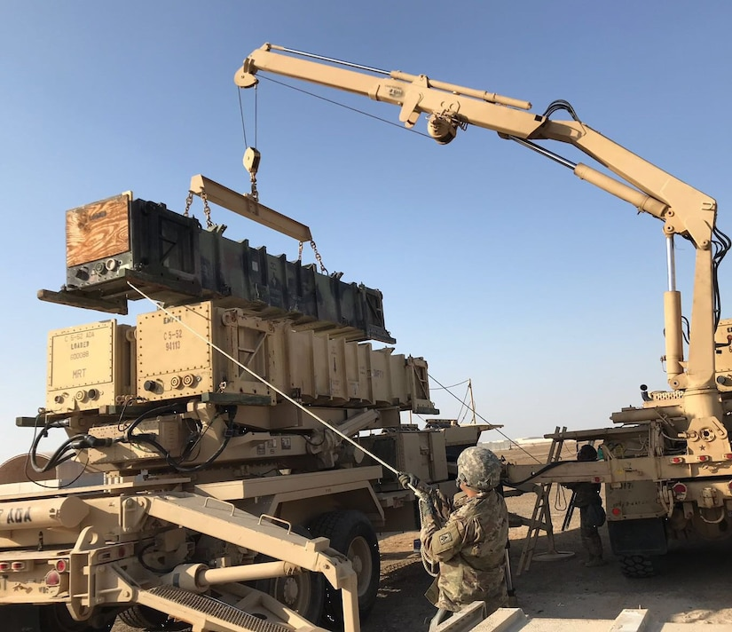 Delta Battery, 1st Battalion, 7th Air Defense Artillery, Top Notch 11th Air Defense Artillery Brigade, reload team executes a guided missile transporter reload at Al Dhafra Air Base, United Arab Emirates, March 19, 2018, to validate their ability to quickly and safely replace interceptors during engagements.