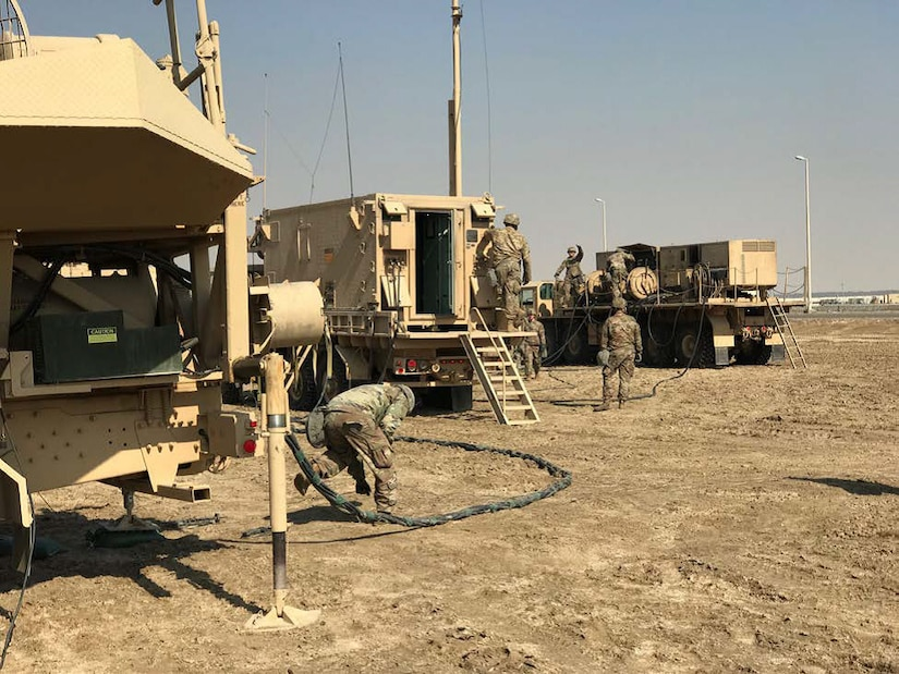 The tactical control assistant waits for the electric power plant to emplace and push Patriot prime power to the engagement control station in order to begin initializing the system Feb. 10, 2018, at Al Dhafra Air Base, United Arab Emirates.