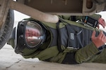 Tech Sgt. John Nelson, an explosive ordnance disposal team leader from the 379th Expeditionary Civil Engineer Squadron, searches a vehicle while wearing an EOD 10 bomb suit during a training scenario at Al Udeid Air Base, Qatar, Feb. 15, 2018.