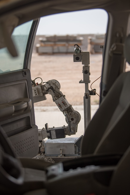An F6B robot is utilized by members of the 379th Expeditionary Civil Engineer Squadron's explosive ordnance disposal unit during a training scenario at Al Udeid Air Base, Qatar, Feb. 15, 2018.