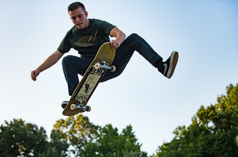 U.S. Air Force Airman 1st Class Nick Whitehurst, 633rd Communications Squadron client systems technician, nose-grabs his skateboard in Smithfield, Va., July 26, 2017.
