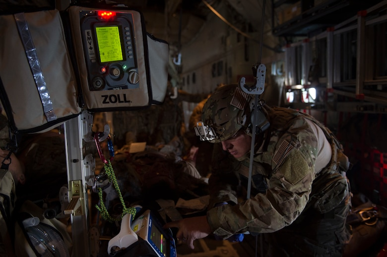 A pararescueman from the 58th Rescue Squadron, Nellis Air Force Base, Nev., provides care to a simulated casualty during Tiger Rescue IV, March 27, 2018, at Vandenberg Air Force Base, Calif. The four-day exercise challenged Airmen from multiple rescue squadrons to bring the capabilities of the personnel recovery triad together to successfully complete rescue missions and maintain proficiency. The three branches of the personnel recovery triad are the HC-130J Combat King II, HH-60G Pave Hawk and the guardian angel weapons system or pararescuemen. (U.S. Air Force photo by Senior Airman Janiqua P. Robinson)