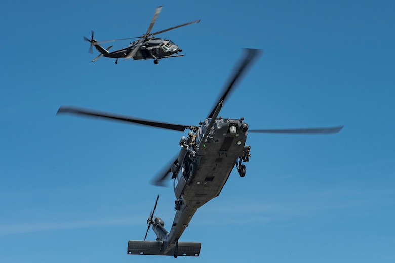 Two HH-60G Pave Hawk Helicopter aircrews from the 55th Rescue Squadron, Davis-Monthan Air Force Base, Ariz., prepare to land during Tiger Rescue IV, March 29, 2018, at Vandenberg Air Force Base, Calif. The four-day exercise challenged Airmen from multiple rescue squadrons to bring the capabilities of the personnel recovery triad together to successfully complete rescue missions and maintain proficiency. The three branches of the personnel recovery triad are the HC-130J Combat King II, HH-60G and the guardian angel weapons system or pararescuemen. (U.S. Air Force photo by Senior Airman Janiqua P. Robinson)
