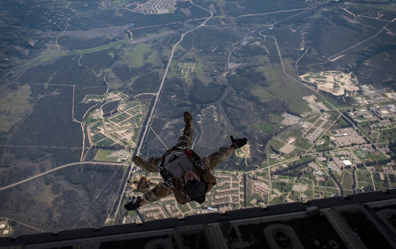 Pararescuemen from the 58th Rescue Squadron, Nellis Air Force Base, Nev., descend onto a drop zone during Tiger Rescue IV, March 30, 2018, at Vandenberg Air Force Base, Calif. The four-day exercise challenged Airmen from multiple rescue squadrons to bring the capabilities of the personnel recovery triad together to successfully complete rescue missions and maintain proficiency. The three branches of the personnel recovery triad are the HC-130J Combat King II, HH-60G Pave Hawk and the guardian angel weapons system or pararescuemen. (U.S. Air Force photo by Senior Airman Janiqua P. Robinson)