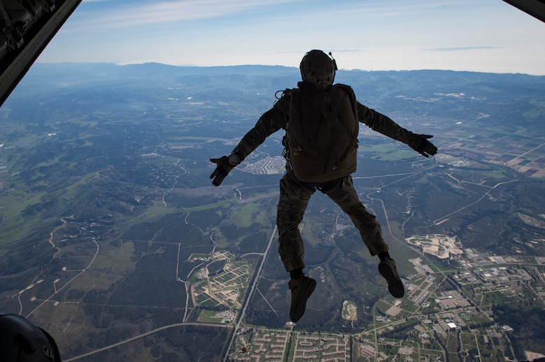 A pararescueman from the 58th Rescue Squadron, Nellis Air Force Base, Nev., descends onto a drop zone during Tiger Rescue IV, March 30, 2018, at Vandenberg Air Force Base, Calif. The four-day exercise challenged Airmen from multiple rescue squadrons to bring the capabilities of the personnel recovery triad together to successfully complete rescue missions and maintain proficiency. The three branches of the personnel recovery triad are the HC-130J Combat King II, HH-60G Pave Hawk and the guardian angel weapons system or pararescuemen. (U.S. Air Force photo by Senior Airman Janiqua P. Robinson)