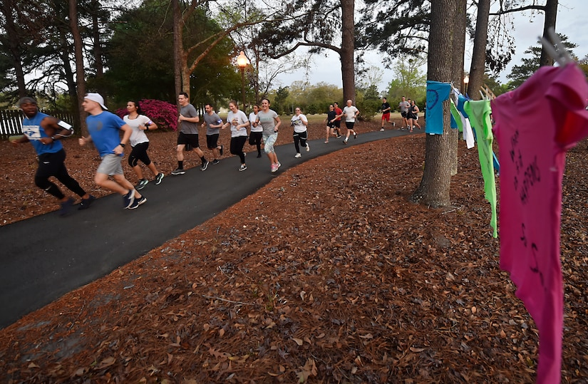 Participants in the Sexual Assault Awareness Prevention and Response color run begin the run at Joint Base Charleston, S.C., March 30, 2018.