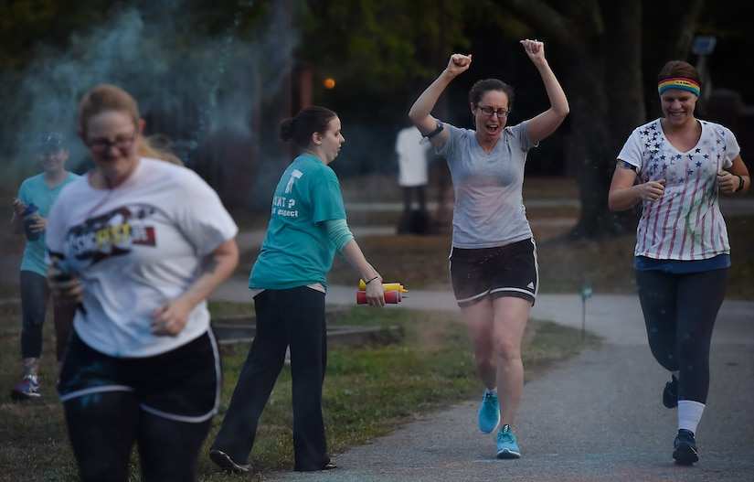 Participants in the Sexual Assault Awareness Prevention and Response color run get covered in different colors at Joint Base Charleston, S.C, March 30, 2018.