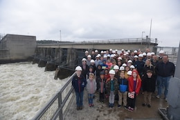 "U.S. Army Corps of Engineers Nashville District employees pose with their children at Old Hickory Dam during a tour March 30, 2018 during ""Bring Your Kids to Work Day."" A total of 36 kids joined their parents for a tour of the dam, lock and power plant. (USACE Photo by Lee Roberts)"