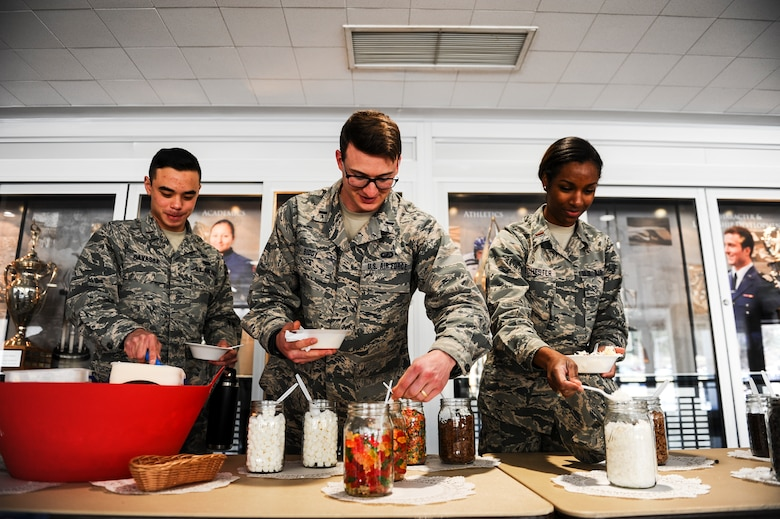 Airmen enjoy the Air Force Assistance Fund campaign's ice cream social April 3, 2018, at Air Force Academy, Colorado. For 45 years, the campaign has evolved into supporting the Air Force Aid Society, Air Force Enlisted Village, Air Force Villages Charitable Foundation and the General and Mrs. Curtis E. LeMay Foundation. (U.S. Air Force photo/Tech. Sgt. Julius Delos Reyes)