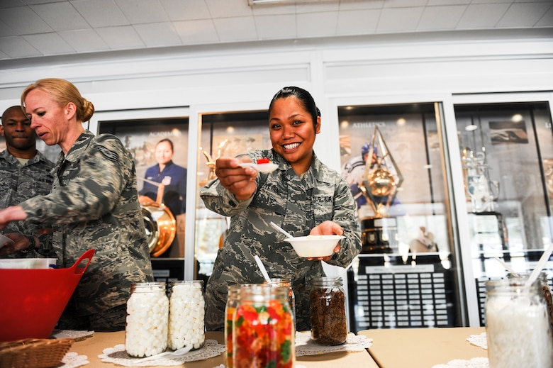 Staff Sgt. Khacy Lava, Headquarters Air Force Academy, enjoys her ice cream during the Air Force Assistance Fund campaign's ice cream social April 3, 2018, at Air Force Academy, Colorado. The campaign is an annual effort to raise funds for the charitable affiliates that provide support to our Air Force family in need, including active duty, retirees, reservists, Guard members and our dependents including surviving spouses. (U.S. Air Force photo/Tech. Sgt. Julius Delos Reyes)