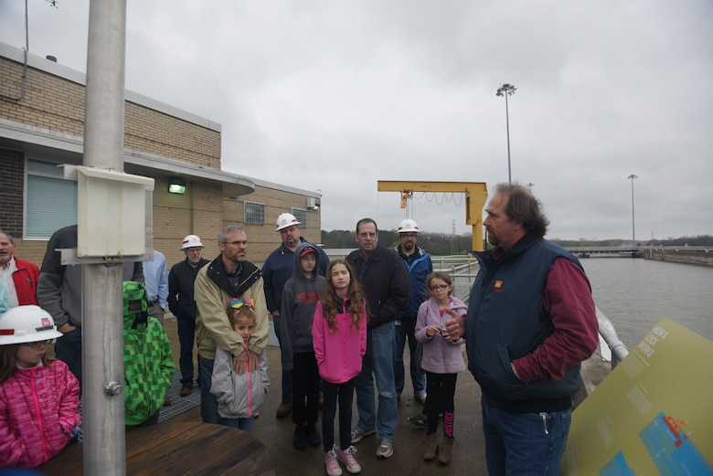 """Skeeter Deskins (Right), U.S. Army Corps of Engineers Nashville District lockmaster at Old Hickory Lock, welcomes children participating in """"Bring Your Kids to Work Day"""" in Old Hickory, Tenn., March 30, 2018. A total of 36 kids joined their parents for a tour of the dam, lock and power plant. (USACE Photo by Lee Roberts)"""