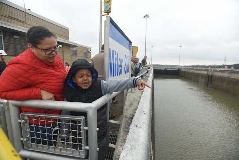 """Camden Powell points toward the gates at Old Hickory Lock and asks his mom Janelle Powell, Resource Management budget analyst, questions about its operation.  They participated in the U.S. Army Corps of Engineers Nashville District """"Bring Your Kids to Work Day"""" and toured Old Hickory Dam, Lock and Power House March 30, 2018. (USACE photo by Lee Roberts)"""