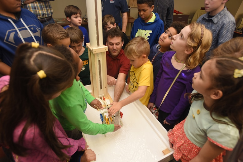 """Project Manager Doug DeLong helps kids with testing the turbine wheels that teams constructed as part of """"Bring Your Kids to Work Day"""" activities March 30, 2018 at the district headquarters in Nashville, Tenn. (USACE Photo by Lee Roberts)"""