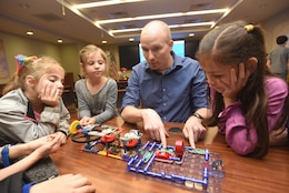 "Ben Lewis, U.S. Army Corps of Engineers Nashville District electrical engineer, explains parallel circuits with kids participating in ""Bring Your Kids to Work Day"" activities March 30, 2018 at the district headquarters in Nashville, Tenn. (USACE Photo by Lee Roberts)"