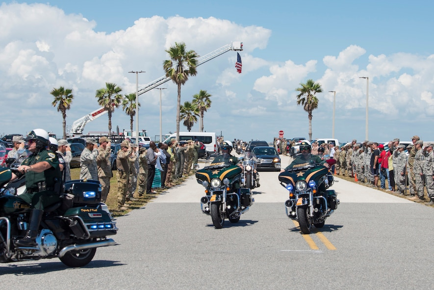 The Patrick Air Force Base community came out in full force to honor Master Sgt. William Posch upon arriving home to Patrick Air Force Base April 3, 2018 at noon. The entire base lined the streets of Patrick Air Force Base to pay respects to him and his family for their ultimate sacrifice during his dignified transfer. Posch, 36, was one of two Pararscuemen the wing lost March 15, 2018 when they were killed in action during an overseas combat deployment to Iraq. Staff Sgt. Carl Enis, 31, was the other. Among the motorcade escorts were Brevard County Sheriff deputies. (U.S. Air Force photo)