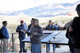 Margie Klein, interpretive naturalist with the Red Rock Canyon Visitor's Center, gives an overview of Red Rock Canyon National Conservation Area to U.S. Army Corps of Engineers geologists before the group heads out to participate in a paleoflood exercise and hike the Keystone Thrust Fault trail March 15 at the conservation area near Las Vegas.
