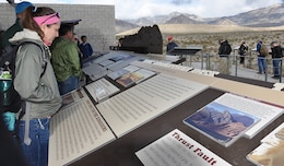 Heather Hickerson, a geologist with the U.S. Army Corps of Engineers' New Orleans District, checks out information at the Red Rock Canyon Visitor's Center before taking part in a paleoflood exercise and hike to the Keystone Thrust Fault March 15 at the Red Rock Canyon National Conservation Area near Las Vegas.