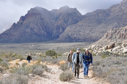 U.S. Army Corps of Engineers geologists and technicians from across the nation, including Keith Kelson, center left, who conducted a paleoflood exercise with the group, hike the Keystone Thrust Fault trail March 15 in the Red Rock Canyon National Conservation Area near Las Vegas.