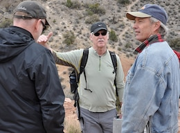 Doug Bliss, chief of the Geotechnical and Engineering Services Branch, Regional Geotechnical Center, with the U.S. Army Corps of Engineers' Alaska District, center, discusses the Keystone Thrust Fault with Keith Kelson, engineering geologist with the Corps' Sacramento District, right, and another geologist during a hike of the fault March 15 at Red Rock Canyon National Conservation Area.