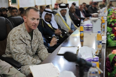 Marine Corps Col. Seth W. Folsom, assigned to Task Force Lion, and key Iraqi security forces leaders discuss regional security resolutions.