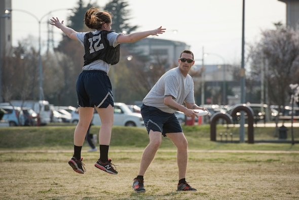 A player jumps to block a pass during an ultimate frisbee match, March 28, 2018, at Yokota Air Base, Japan.