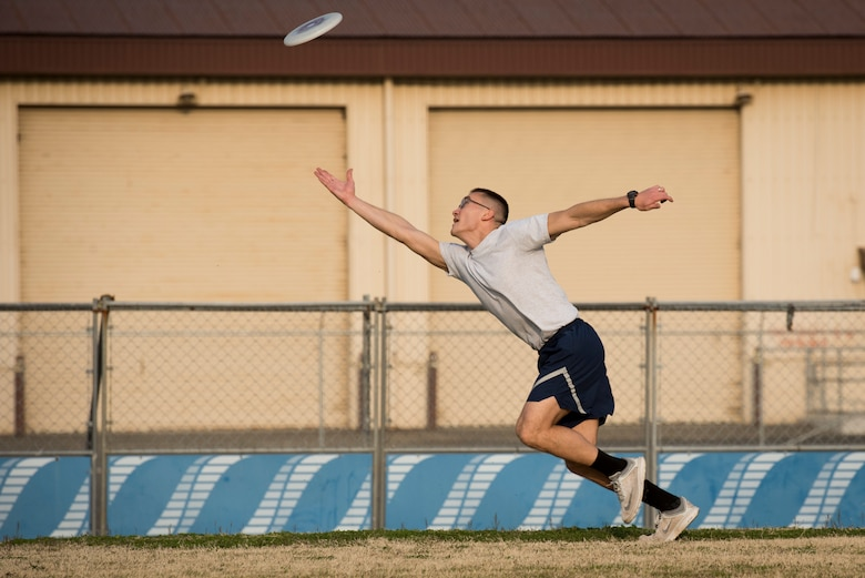 A player dives for the disk in the end zone during an ultimate frisbee match, March 28, 2018, Yokota Air Base, Japan.