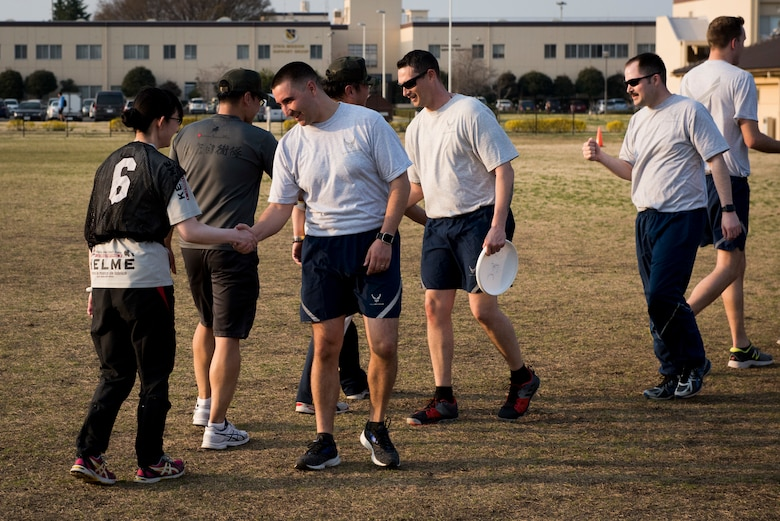 Opposing teams congratulate each other after playing ultimate frisbee, March 28, 2018, Yokota Air Base, Japan.