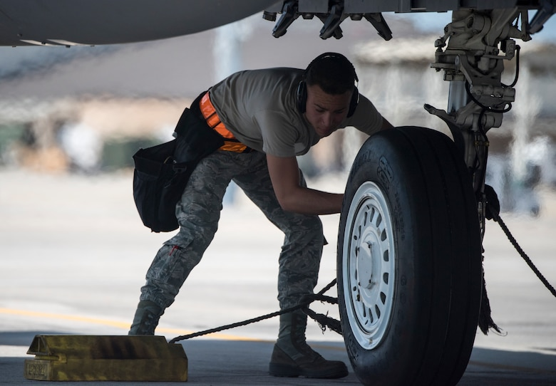 Airman 1st Class Omar Rodriguez, 391st Aircraft Maintenance Unit weapons specialist, places the tire chalks around the tire of an F-15E Strike Eagle April 2, 2018, at Tyndall Air Force Base, Florida. The 391st Fighter Squadron participated in Combat Archer and Hammer, which allowed them to practice air-to-air and air-to-ground maneuvers.