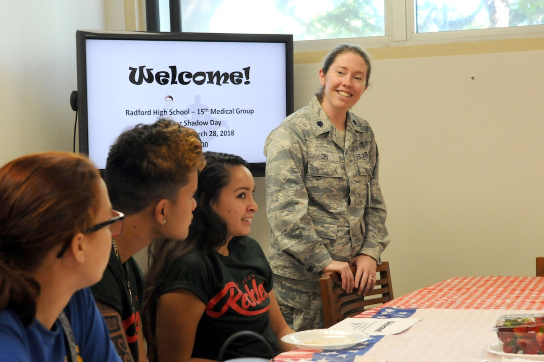 Lt. Col. Kasi M. Chu, 15th Medical Operations Squadron staff physician, welcomes students from Radford High School to Career Shadow Day at the 15th Medical Group, Joint Base Pearl Harbor-Hickam, Hawaii, March 28, 2018.