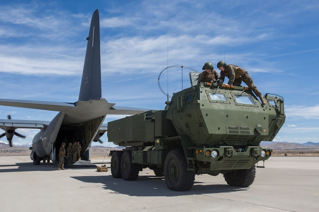 Marines from Kilo Battery, 2nd Battalion, 14th Marine Regiment, reassemble an M142 High Mobility Artillery Rocket System (HIMARS) after being transported on an Air Force MC-130, at Dugway Proving Grounds, Utah, March 30, 2018. Marines from Kilo Battery flew from Fort Campbell, Ky., to Dugway where they offloaded and fired four HIMARS missiles, demonstrating a unique capability that will give commanders more options to deal with threats when other options are not appropriate. (Marine Corps photo by Lance Cpl. Niles Lee)