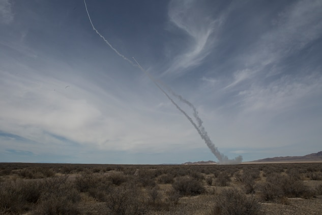 A Marine Corps M142 High Mobility Artillery Rocket System (HIMARS) from Kilo Battery, 2nd Battalion, 14th Marine Regiment, fires two missiles, at Dugway Proving Grounds, Utah, March 30, 2018. Marines from Kilo Battery flew from Fort Campbell, Ky., to Dugway where they offloaded and fired four HIMARS missiles, demonstrating a unique capability that will give commanders more options to deal with threats when other options are not appropriate. (Marine Corps photo by Lance Cpl. Niles Lee)