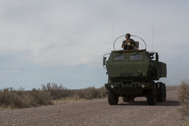 A Marine Corps M142 High Mobility Artillery Rocket System (HIMARS) returns to an airstrip after a fire mission, at Dugway Proving Grounds, Utah, March 30, 2018. Marines from Kilo Battery flew from Fort Campbell, Ky., to Dugway where they offloaded and fired four HIMARS missiles, demonstrating a unique capability that will give commanders more options to deal with threats when other options are not appropriate. (Marine Corps photo by Lance Cpl. Niles Lee)