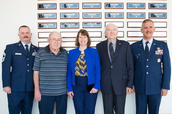 The Air Force Technical Applications Center at Patrick AFB, Fla., inducted three members to its historic Wall of Honor at a ceremony held March 27, 2018 in the center's Doyle Northrup Auditorium.  The inductees were Lt. Col. (ret.) Robert E. Wiley, Chief Master Sgt. (ret.) William J. McClelland, and Chief Master Sgt. (ret.) Susan J. Spencer.  Pictured here in front of the newly-engraved plaques are Chief Master Sgt. Wesley A. Schuler, AFTAC superintendent; McClelland; Doris Bruner, proxy for Spencer; Wiley; and Col. Greg Sawyer, AFTAC vice commander.  (U.S. Air Force photo by Phillip C. Sunkel IV)
