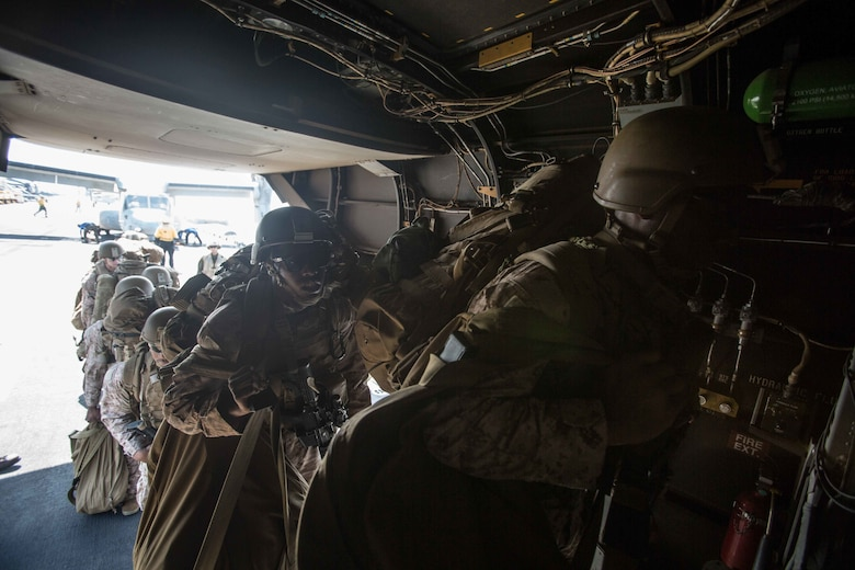 180402-M-WP334-0012 U.S. 5TH FLEET AREA OF OPERATIONS (April 2, 2018) U.S. Marines assigned to the Maritime Raid Force (MRF), 26th Marine Expeditionary Unit (MEU), board an MV-22B Osprey, assigned to Marine Medium Tiltrotor Squadron (VMM) 162 (Reinforced), 26th MEU, on the flight deck of the Wasp-class amphibious assault ship USS Iwo Jima (LHD 7), April 2, 2018. Led by Naval Amphibious Force, Task Force 51/5th Marine Expeditionary Brigade, Alligator Dagger integrates U.S. Navy and Marine Corps assets to practice and rehearse a range of critical capabilities available to U.S. Central Command both afloat and ashore to promote stability and security in the region.