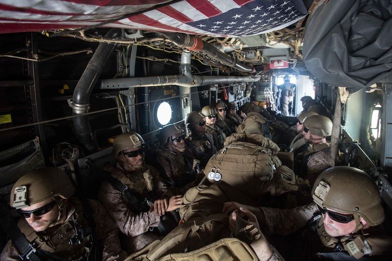 180402-M-WP334-0019 U.S. 5TH FLEET AREA OF OPERATIONS (April 2, 2018) U.S. Marines assigned to the Maritime Raid Force (MRF), 26th Marine Expeditionary Unit (MEU), ride in an MV-22B Osprey, assigned to Marine Medium Tiltrotor Squadron (VMM) 162 (Reinforced), 26th MEU during Alligator Dagger, April 2, 2018. Led by Naval Amphibious Force, Task Force 51/5th Marine Expeditionary Brigade, Alligator Dagger integrates U.S. Navy and Marine Corps assets to practice and rehearse a range of critical capabilities available to U.S. Central Command both afloat and ashore to promote stability and security in the region.