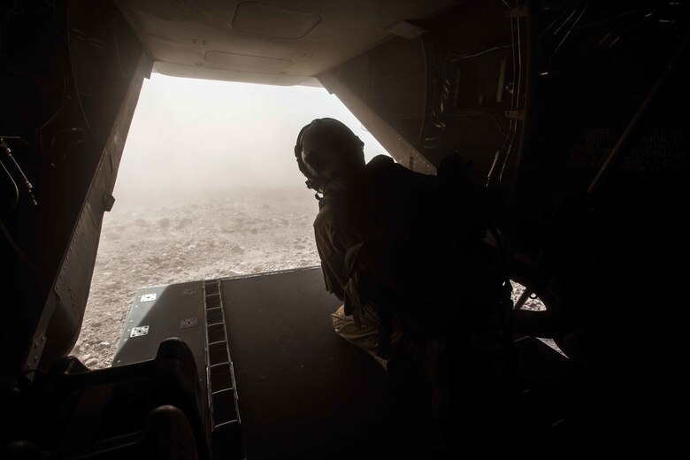 180402-M-WP334-0027 ARTA RANGE, Djibouti (April 2, 2018) U.S. Marine Corps Lance Cpl. Bailey Quinn, an MV-22B Osprey crew chief assigned to Marine Medium Tiltrotor Squadron (VMM) 162 (Reinforced), 26th Marine Expeditionary Unit, observes the surroundings from the inside of an MV-22B Osprey prior to landing during Alligator Dagger in Arta Range, Djibouti, April 2, 2018. Led by Naval Amphibious Force, Task Force 51/5th Marine Expeditionary Brigade, Alligator Dagger integrates U.S. Navy and Marine Corps assets to practice and rehearse a range of critical capabilities available to U.S. Central Command both afloat and ashore to promote stability and security in the region.