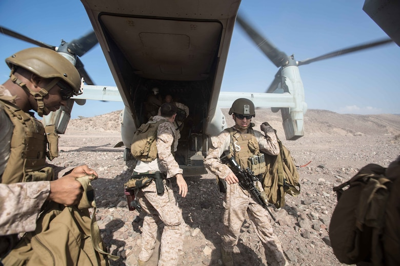 180402-M-WP334-0040 ARTA RANGE, Djibouti (April 2, 2018) U.S. Marines assigned to the Maritime Raid Force (MRF), 26th Marine Expeditionary Unit (MEU), offload gear from an MV-22B Osprey, assigned to Marine Medium Tiltrotor Squadron (VMM) 162 (Reinforced), 26th MEU, in Arta Range, Djibouti, April 2, 2018. Led by Naval Amphibious Force, Task Force 51/5th Marine Expeditionary Brigade, Alligator Dagger integrates U.S. Navy and Marine Corps assets to practice and rehearse a range of critical capabilities available to U.S. Central Command both afloat and ashore to promote stability and security in the region