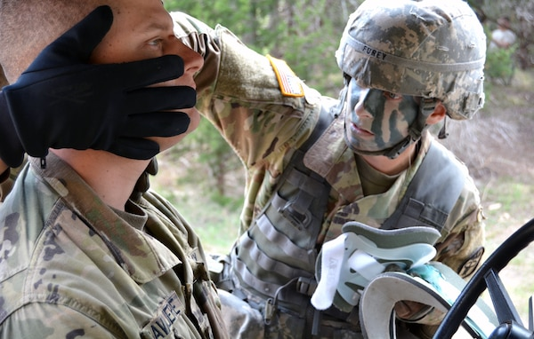 Army 1st Lt. Devon Furey completes a complex medical and evacuation scenario on combat testing lane one during Expert Field Medical Badge testing at Joint Base San Antonio-Camp Bullis March 26.
