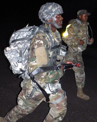 Army Spc. Harold Owiti marches in the early morning hours of March 28 at Joint Base San Antonio-Camp Bullis during Expert Field Medical Badge testing. Owiti was the first to finish the foot march with a time of 2:33:08.