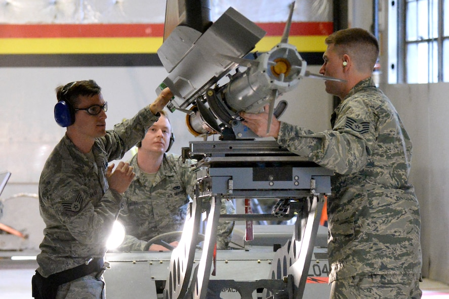 Tech. Sgt. Daniel Pas, Staff Sgt. Richard Shafer, and Staff Sgt. Elliot Berg represent the 419th Aircraft Maintenance Squadron during an F-35 weapons load competition