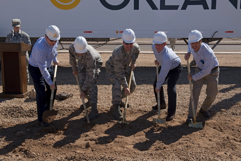 Representatives from the partners in the construction of the 56th Communications Squadron's future operations building dig the first holes during the building's groundbreaking ceremony at Luke Air Force Base, Ariz., March 28, 2018. The partners include the 56th CS, the 56th Civil Engineer Squadron, the Army Corps of Engineers, and private contractors. (U.S. Air Force photo by Senior Airman Ridge Shan)