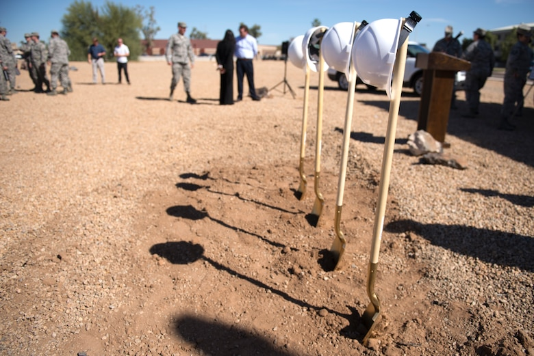 Construction helmets sit atop painted shovels before the start of the groundbreaking ceremony for the 56th Communications Squadron's new facility at Luke Air Force Base, Ariz., March 28, 2018. The new facility will consolidate the 56th CS, currently split between three locations, into one location for the first time. (U.S. Air Force photo by Senior Airman Ridge Shan)